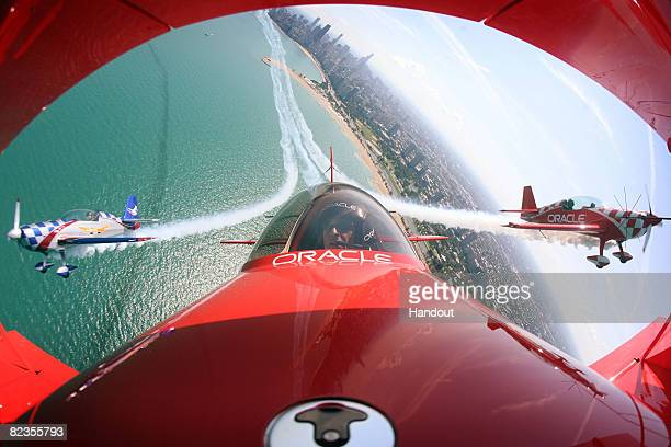 Pilot Sean Tucker his son Eric and Ben Freelove fly their aircraft over Lake Michigan as they prepare for this weekend's Chicago Air and Water Show...