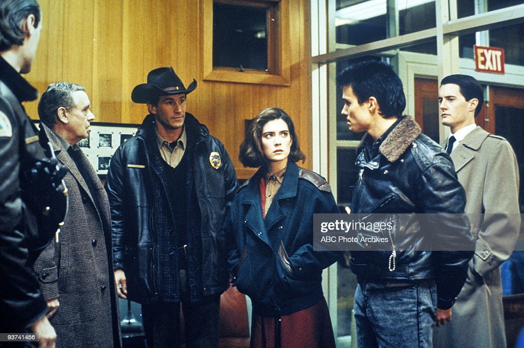 PEAKS - Pilot - Season One - 4/8/1990, Homecoming queen Laura Palmer is found dead, washed up on a riverbank wrapped in plastic sheeting. FBI Special Agent Dale Cooper (Kyle MacLaughlin, far right) is called in to investigate the gruesome murder in the small Northwestern town of Twin Peaks. Pictured: Deputy Tommy 'Hawk' Hill (Michael Horse), Dr. William Hayward (Warren Frost), Sheriff Harry S. Truman (Michael Ontkean) and Donna Hayward (Lara Flynn Boyle) confront James Hurley (James Marshall), the secret love of Laura Palmer.,