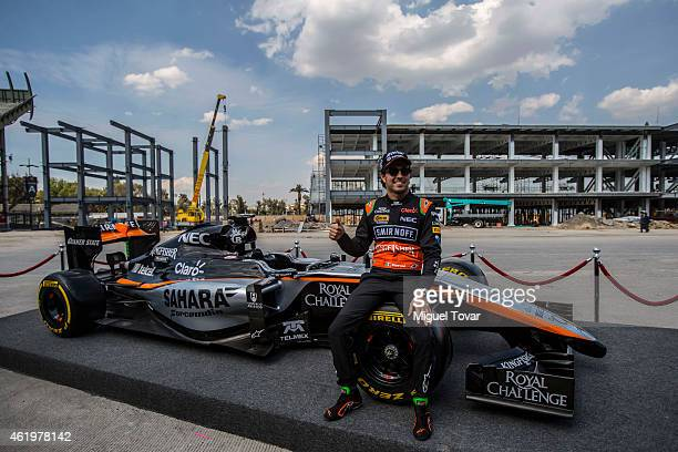 Pilot Sergio Checo Perez poses for pictures during a walk through the Hermanos Rodriguez Racing Circuit Facilities on January 22, 2015 in Mexico...