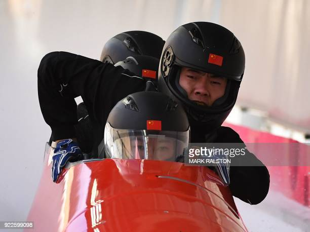 Pilot Shao Yijun of China leads his team as they cross the finish line in the 4man bobsleigh training during the Pyeongchang 2018 Winter Olympic...