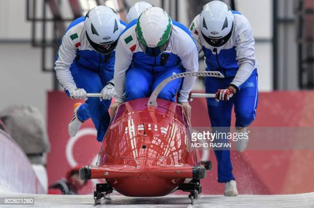 Pilot Simone Bertazzo of Italy leads his team as they start the 4man bobsleigh training session during the Pyeongchang 2018 Winter Olympic Games at...