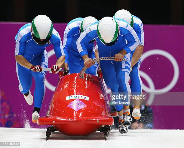 Pilot Simone Bertazzo Simone Fontana Samuele Romanini and Francesco Costa of Italy team 1 make a run during the Men's Four Man Bobsleigh heats on Day...