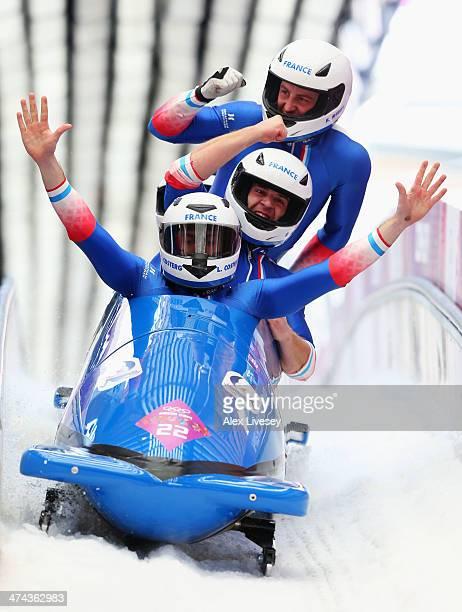 Pilot Simone Bertazzo Simone Fontana Samuele Romanini and Francesco Costa of Italy team 1 react after a run during the Men's FourMan Bobsleigh on Day...