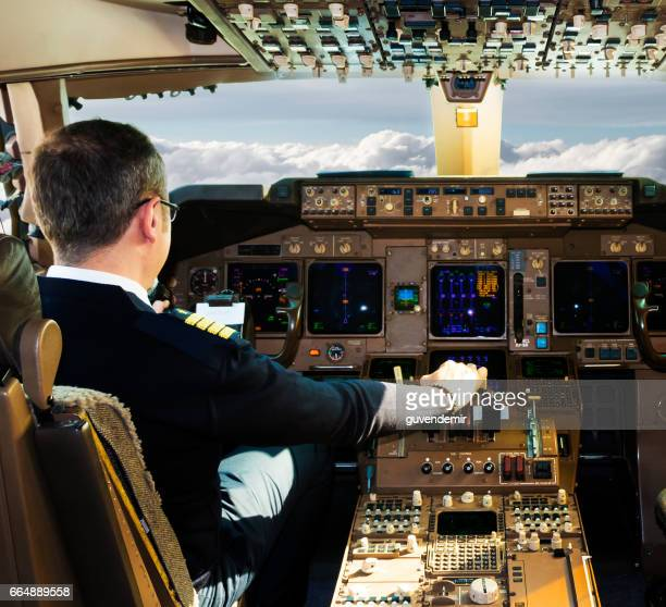 Pilot sitting in airplane cockpit