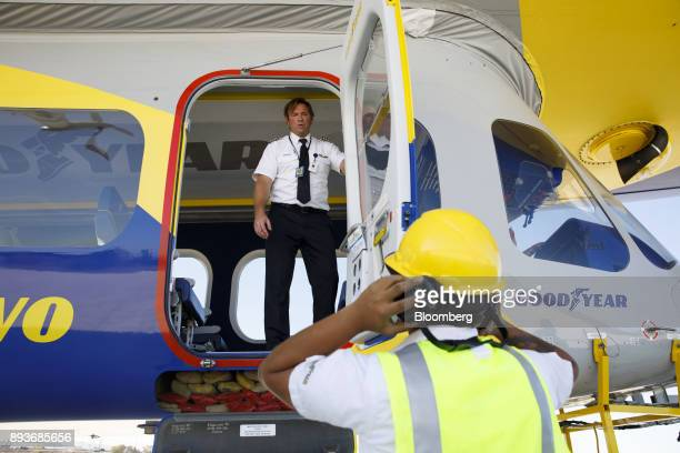 A pilot speaks with a ground crew member after landing the Goodyear Tire Rubber Co Wingfoot Two blimp at the company's airship base in Carson...
