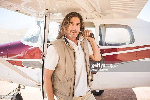 pilot standing beside plane, wellington, western cape, south africa - khaki stock pictures, royalty-free photos & images