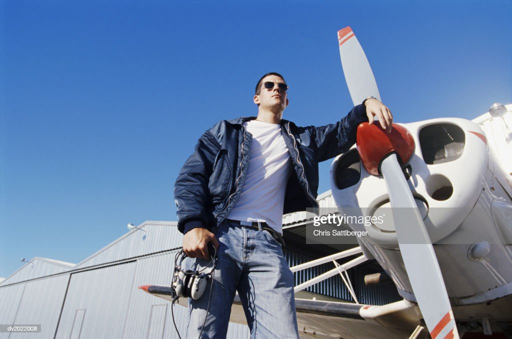 Pilot Standing by a Propeller Aeroplane : Stock Photo