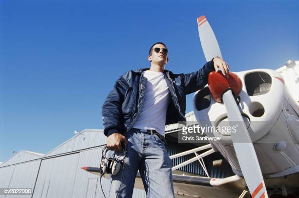 Pilot Standing by a Propeller Aeroplane