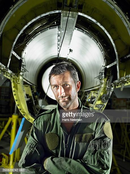 pilot standing in front of aircraft jet in hangar, portrait - hans neleman ストックフォトと画像
