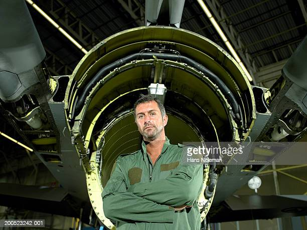 pilot standing in front of aircraft shell in hangar, portrait - hans neleman ストックフォトと画像