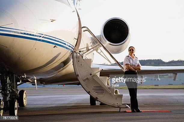 Pilot Standing with Executive Jet