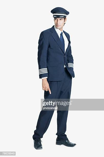 pilot standing with his hand in his pocket - uniform cap stock pictures, royalty-free photos & images