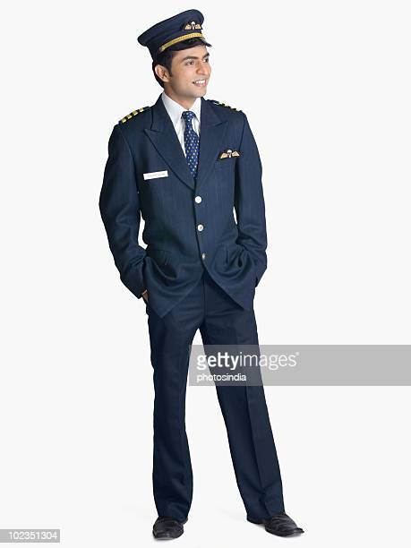 Pilot standing with his hands in his pockets and smiling