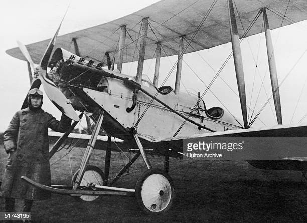 A pilot stands next to his De Havilland BE2 which was used as an early bomb carrier 1914 A small number of bombs would be released from the plane by...
