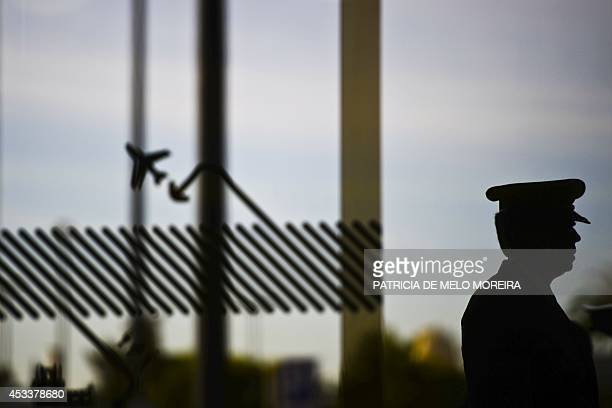 A pilot stands outside Lisbon's Airport during a strike on August 9 2014 Pilots at Portuguese stateowned airline TAP staged a 24hour strike over...