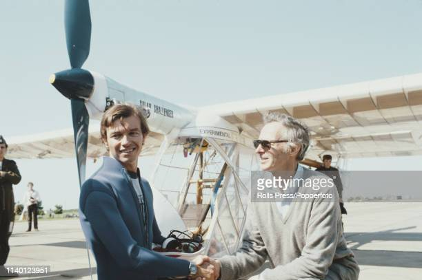 Pilot Stephen Ptacek shakes hands with aeronautical engineer and team leader Paul MacCready after flying the solarpowered electric aircraft 'Solar...