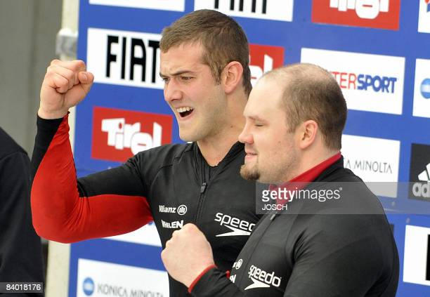 US pilot Steven Holcomb and brakeman Justin Olsen celebrate in the finish area after taken the third place in the Bobleigh World Cup competition in...