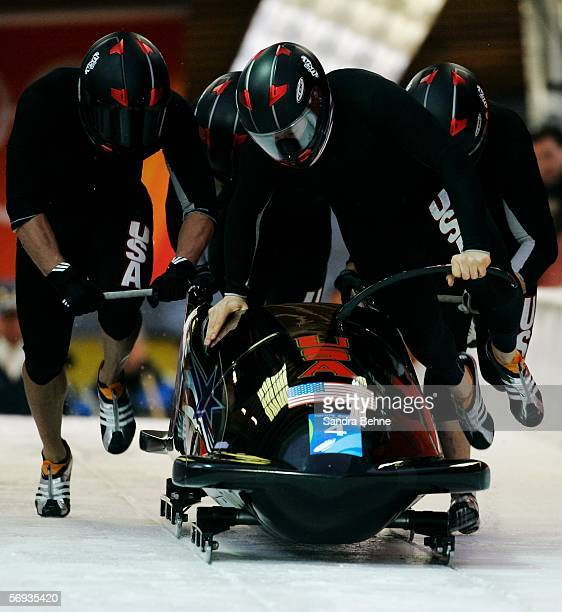 Pilot Steven Holcomb and teammates Curt Tomasevicz Bill Schuffenhauer and Lorenzo Smith III of United States 2 compete in the Four Man Bobsleigh...
