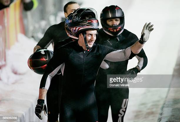 Pilot Steven Holcomb and teammates Curt Tomasevicz Bill Schuffenhauer and Lorenzo Smith III of United States 2 leave the track after their final run...
