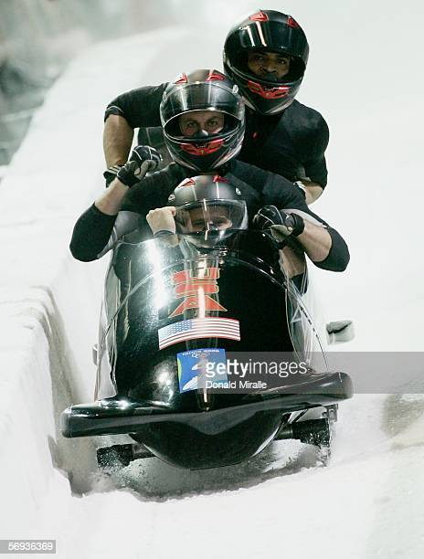Pilot Steven Holcomb and teammates Curt Tomasevicz Bill Schuffenhauer and Lorenzo Smith III of United States 2 celebrate after their final run in the...