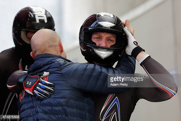 Pilot Steven Holcomb Curtis Tomasevicz Steven Langton and Christopher Fogt of the United States team 1 react after their final run during the Men's...