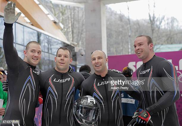 Pilot Steven Holcomb Curtis Tomasevicz Steven Langton and Christopher Fogt of the United States team 1 react after a run during the Men's Four Man...