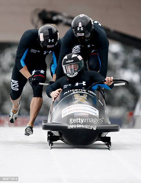 Pilot Steven Holcomb Justin Olsen Steve Mesler and Curtis Tomasevicz of USA compete in their first run of the four man bobsleigh competition during...