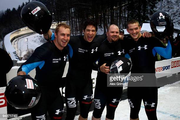 Pilot Steven Holcomb of USA celebrates with his team members Justin Olsen Steve Mesler and Curtis Tomasevicz after winning the four man bobsleigh...