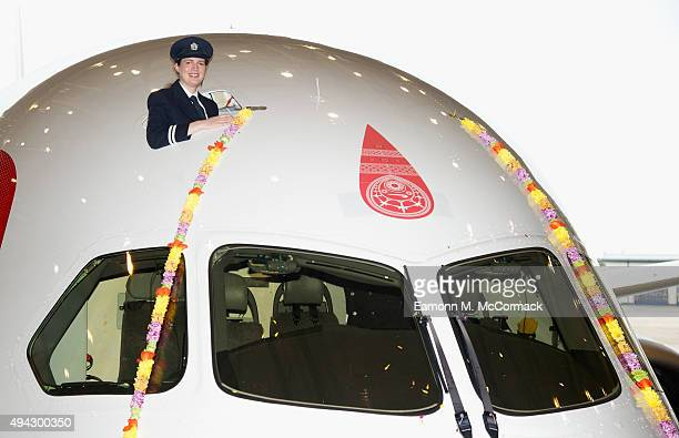 Pilot Suneil Banerjee poses in the cockpit of new British Airways Boeing 7879 Dreamliner adorned with a flower garland during a photo shoot to mark...