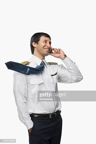 Pilot talking on a mobile phone