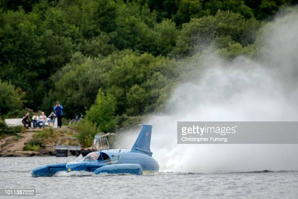 Pilot Ted Walsh fires up the jet engine Donald Campbell's iconic Bluebird as it propels on the waters of Loch Fad for the first time for 50 years on...
