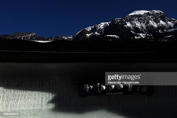 Pilot Thomas Florschuetz of Germany 3 competes with his team mates Ronny Listner, Kevin Kuske and Andreas Barucha in the first run of the men's four...