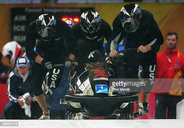 Pilot Todd Hays Pavle Jovanovic Steve Mesler and Brock Kreitzburg of the United States 1 compete in the Four Man Bobsleigh event on Day 14 of the...