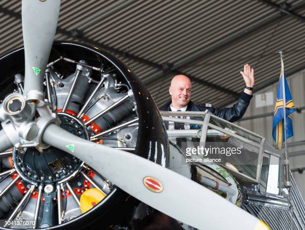 Pilot Uwe Wendt in the cockpit of a historic Junkers Ju 52 aircraft in a hangar in Hamburg Germany 6 April 2017 The plane known colloquially as Aunt...