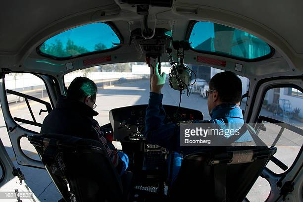 Pilot Victor Torres right and a radio control operator members of the Condor Group wait to take off following a flight inspection in Mexico City...