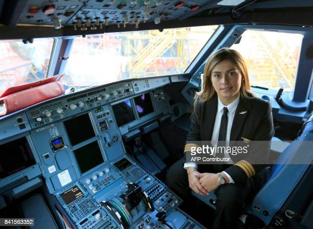 Pilot Viviana Bastos poses in the cockpit of the Airbus A320 operated by Avianca which will transport Pope Francis during his upcoming visit to...