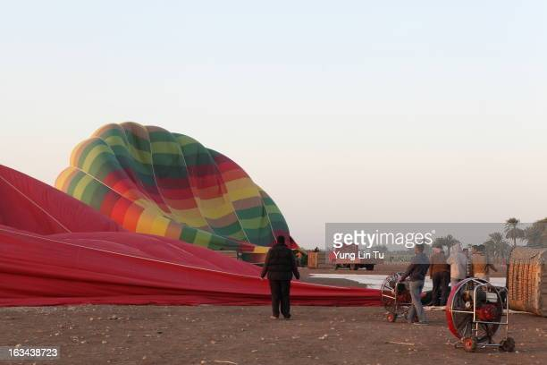 CONTENT] Pilot watching the balloon being inflated