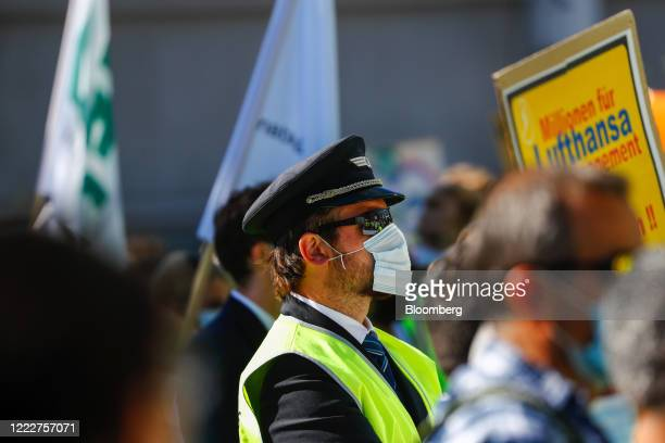 A pilot wearing a protective face mask during a protest by Deutsche Lufthansa AG employees and union members outside the Lufthansa Aviation Center at...