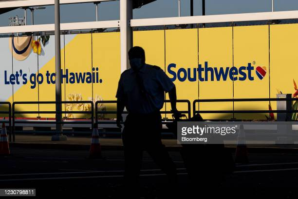Pilot wearing a protective mask walks to a Southwest Airlines Co. Terminal at Oakland International Airport in Oakland, California, U.S., on Tuesday,...