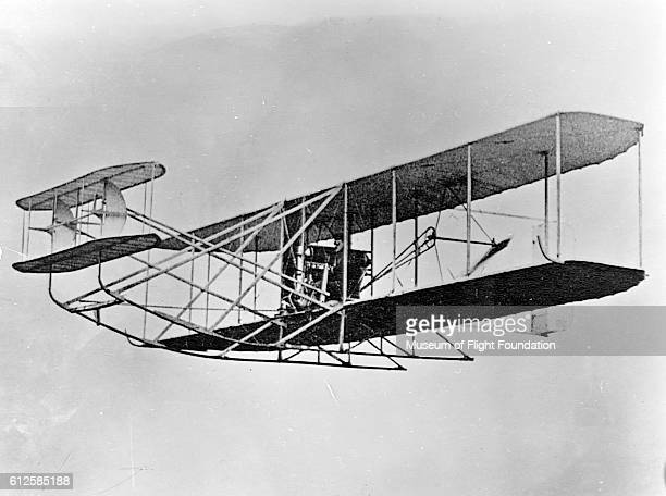 Pilot Wilbur Wright takes his Wright Flyer prototype biplane on a demonstration flight in Germany in the Fall of 1909 | Location Tempelhof Field...