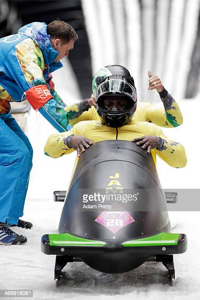 Pilot Winston Watts and Marvin Dixon of Jamaica team 1 finish a run during the Men's TwoMan Bobsleigh on Day 10 of the Sochi 2014 Winter Olympics at...