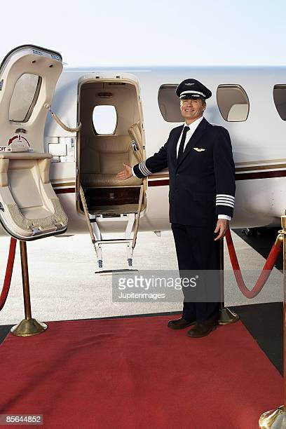 Pilot with airplane and red carpet