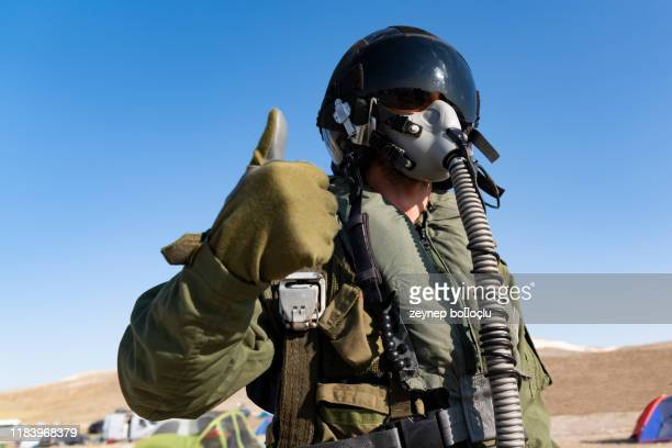 pilot with suit and military air. fighter pilot portrait posing - technology trade war stock pictures, royalty-free photos & images