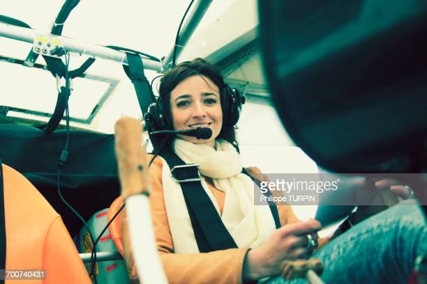pilot young woman in the cockpit of her microlight. - aereo ultraleggero foto e immagini stock