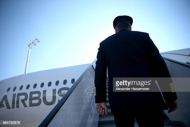 A pilote walks up the gangway of the new Airbus A350X WB passenger plane as he stands on the tarmac at Munich Airport during a presentation of the...