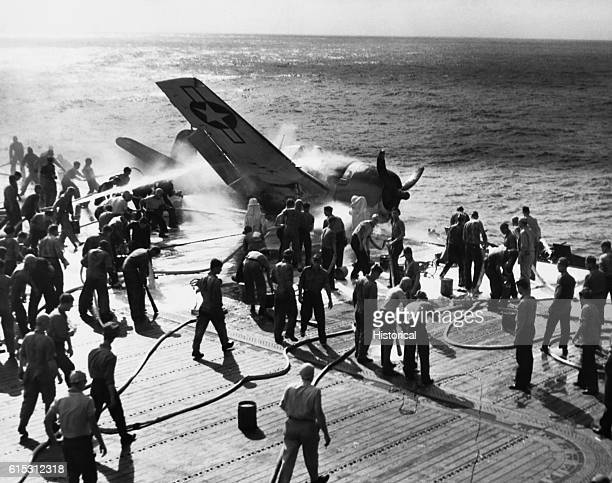 Piloted by Ensign Byron M Johnson this F6F Hellcat crashes onto the deck of the USS Enterprise while en route to attack Makin Island in the Gilbert...