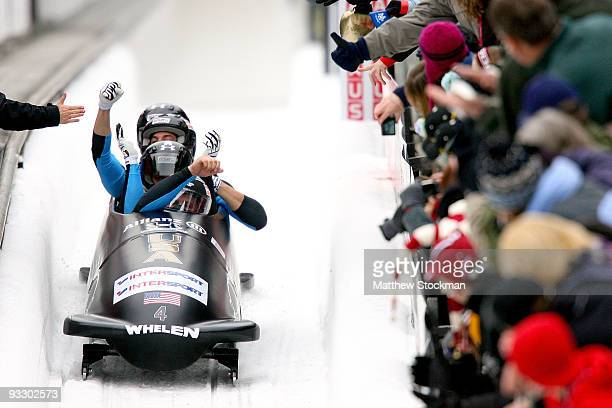 USA 1 piloted by Steven Holcomb celebrates as they cross the finish line in the second run of the 4man bobsled competition during the FIBT Bob...