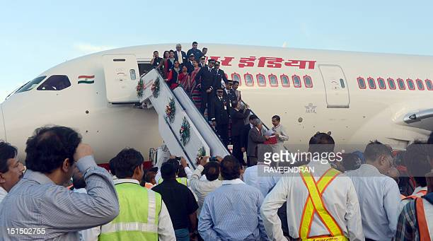 Pilots and air hostesses alight from Air India's first Boeing 787 Dreamliner from Charleston USA after it landed at Indira Gandhi International...