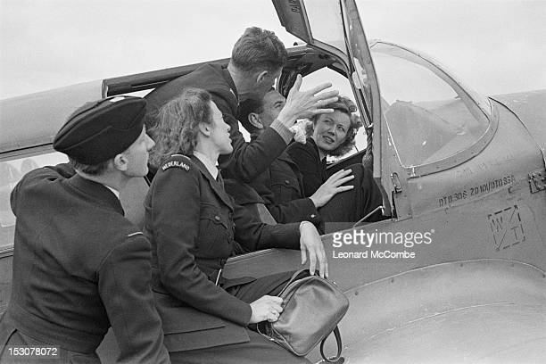 Pilots and engineering officers of the ATA hold a discussion in the cockpit of a Percival Proctor training aircraft at the Elementary Flying Training...