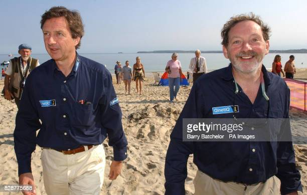 Pilots Andy Elson and Colin Prescot return to Carbis Bay beach in StIves Cornwallafter their aborted attempt to make an historic flight to the edge...